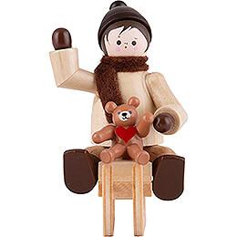 Thiel - Figur Winterkind mit Teddy auf Schlitten  -  6cm
