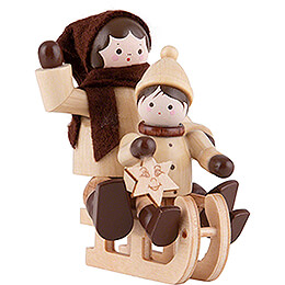 Thiel Figurine  -  Sledge Lady with Child  -  natural  -  5,5cm / 2.2 inch